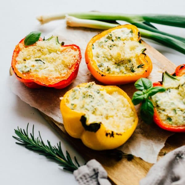 These Herby Ricotta Stuffed Peppers taste straight out of Tuscany with fresh herbs, creamy ricotta, and sharp parmesan.