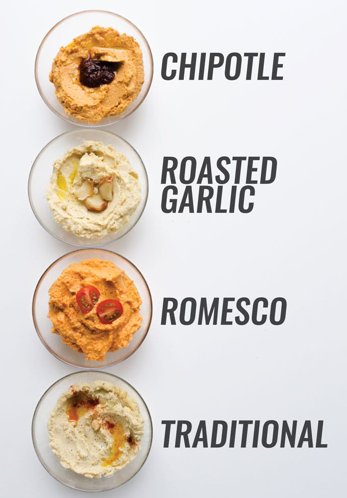 Flavored hummus in bowls on a white background - How to make hummus in the four best flavors: traditional, roasted garlic, chipotle, and romesco! In just 5 minutes and with minimal ingredients, you can have smooth and creamy homemade hummus.