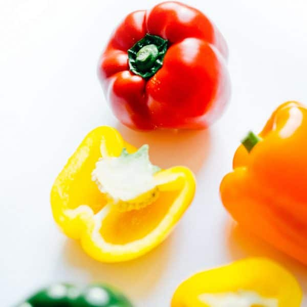 Our favorite vegetarian bell pepper recipes to give you dinnertime inspiration! From how to roast them, how to make romesco sauce, and how to incorporate them into easy sushi and salad, let these recipes inspire your healthy dinner tonight.