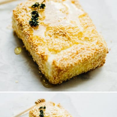 Baked feta on a marble white background with thyme - This Sesame Crusted Baked Feta is easy to make and is the prefect appetizer with some pita chips and fresh veggies.