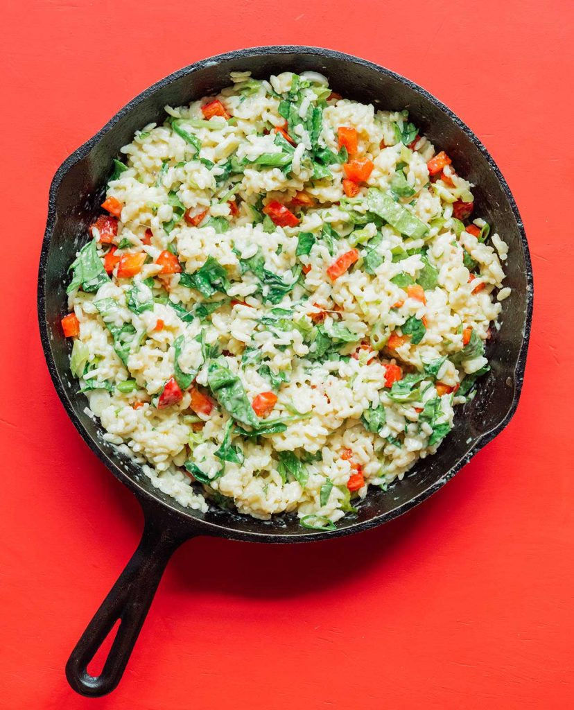 A cast iron skillet filled with cooked gorgonzola pepper risotto