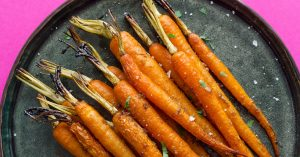 With just five ingredients and two simple steps, these Slow Cooker Carrots are a seriously easy side dish recipe for tonight (plus they're infused with garlic and balsamic...helllooo flavor-town).