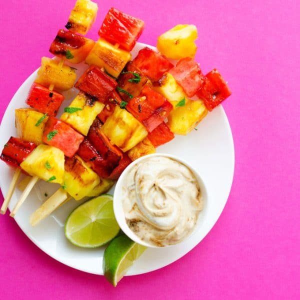 These Watermelon and Pineapple Grilled Fruit Skewers have just 4 ingredients and are dipped in a simple yogurt sauce. Throw them on the BBQ for a quick and healthy dessert this summer!