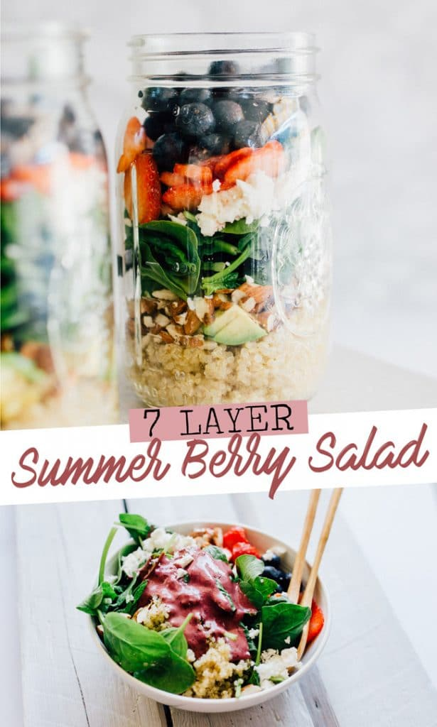 Layered salad in a mason jar with a white marble background - This 7-Layer Summer Berry Salad Jar is a filling and flavorful meal to-go that will get you excited for lunchtime!