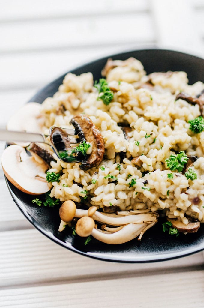 Mushroom risotto on a plate with a fork