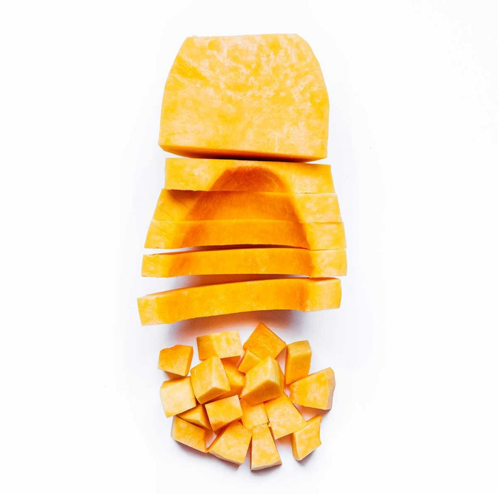 How to cut a butternut squash on a white background