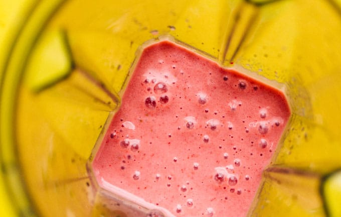 A quick and healthy Strawberry Pomegranate Smoothie, made ultra-creamy with yogurt and bananas and made frosty with frozen fruit.