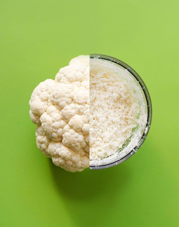 Turning head of cauliflower into cauliflower rice on green background