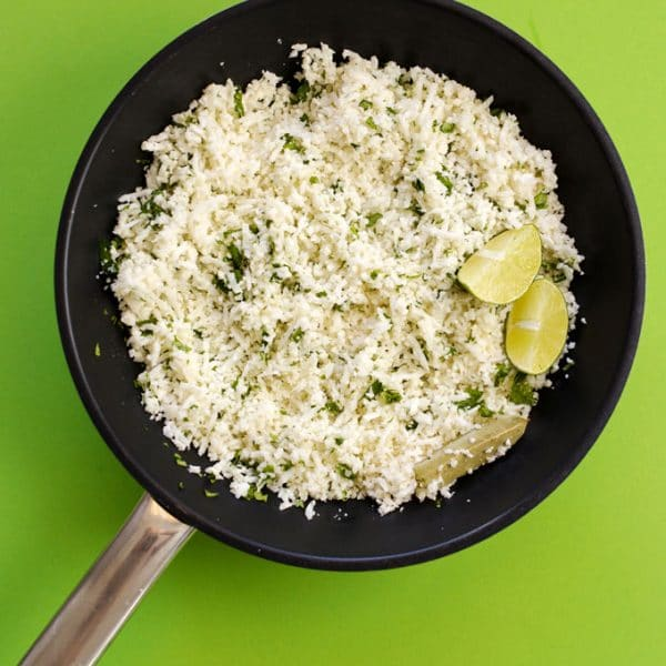 This Chipotle Copycat Cauliflower Rice packs all the signature lime and cilantro flavors of your favorite Chipotle rice (but in low carb cauliflower rice form!)