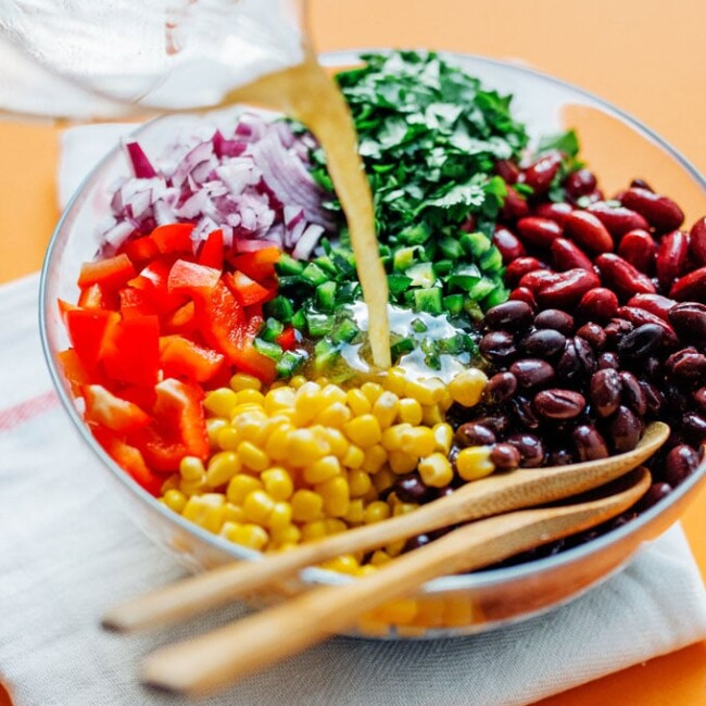 This easy Bean Salad recipe is famous in our house, and for good reason! Quick to make, packed with flavor, and perfect for bringing to potlucks!