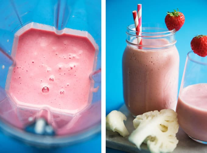 Hidden cauliflower smoothie with strawberry and paper straws in a glass on a blue background