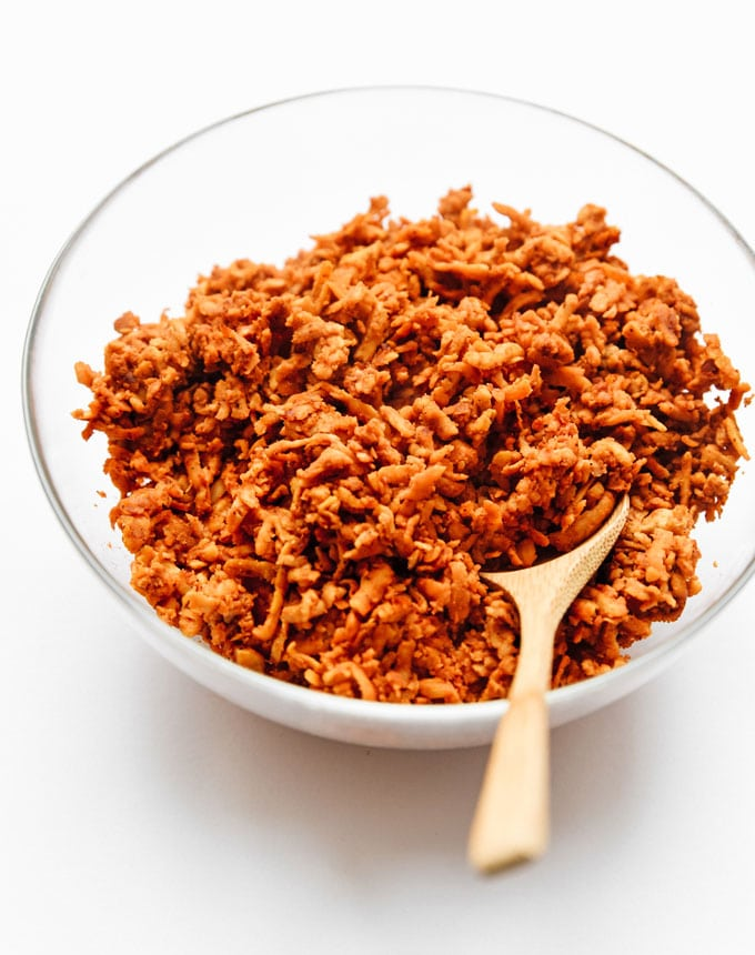 Vegan tempeh taco meat in bowl on white background