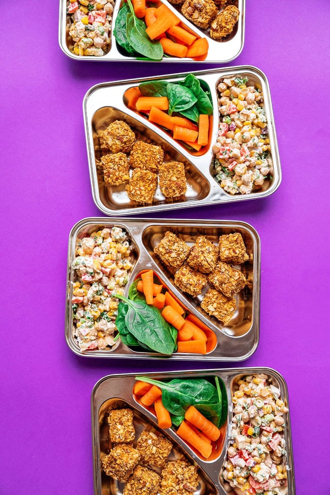 Vegetarian meal prep that's sure to keep you full all day. Almond crusted tofu nuggets paired with a creamy, veggie-packed chickpea corn salad!