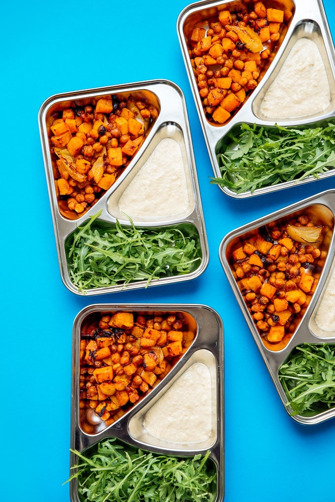 This Butternut Bowl Meal Prep is packed with spiced roasted chickpeas and butternut, drizzle with lemony hummus sauce, and is totally vegan!