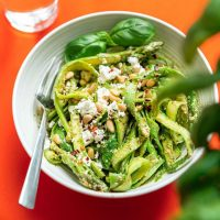 Asparagus noodles recipe, a low carb asparagus pasta on a red background