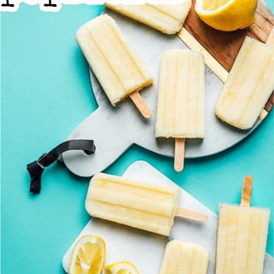 Lemon buttermilk popsicles with ice on a marble slab
