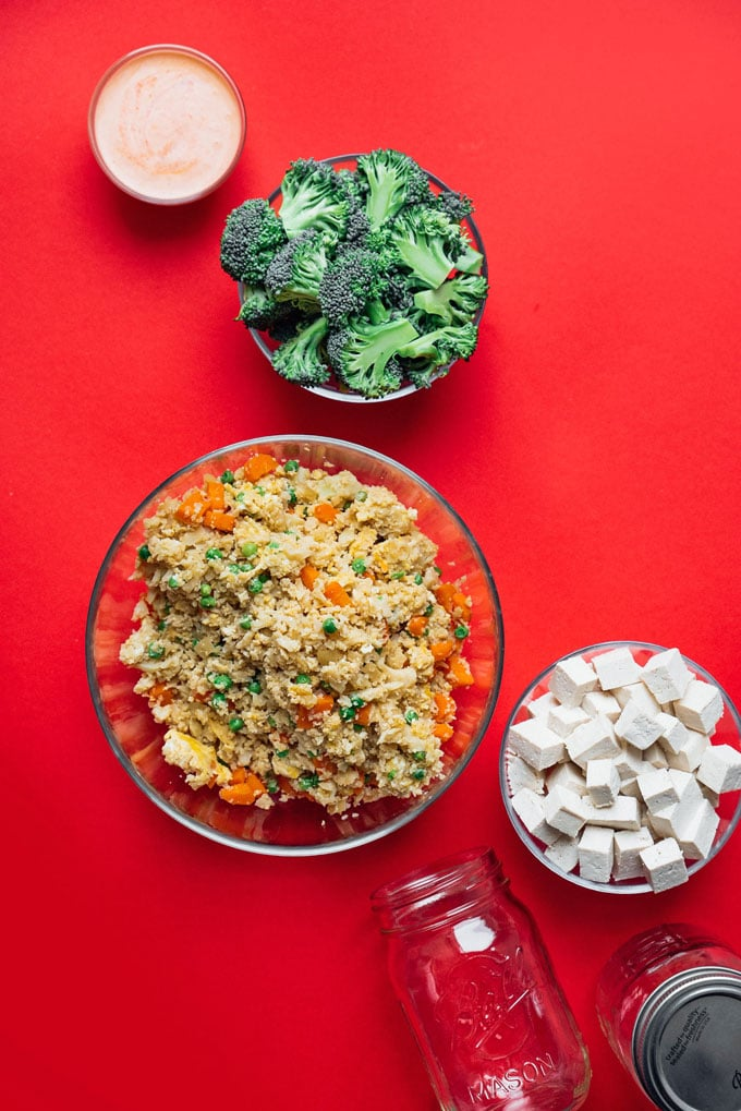 Vegetarian stir fry meal prep idea ingredients on a red background