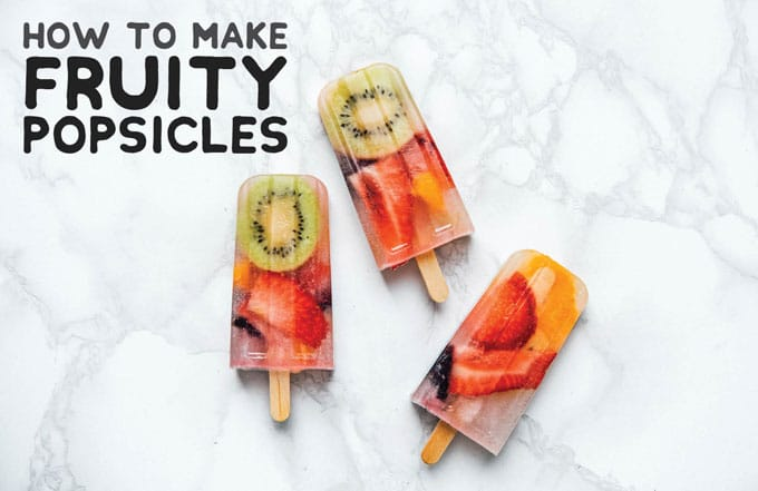 Healthy homemade popsicles recipe photo on a marble background
