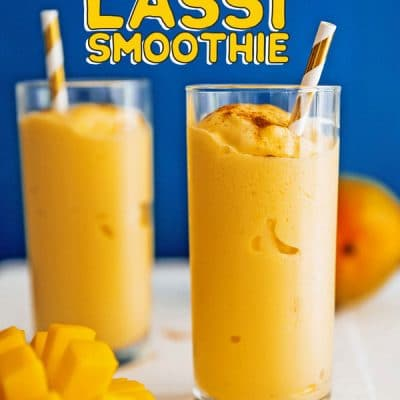 Mango lassi in a glass with a straw
