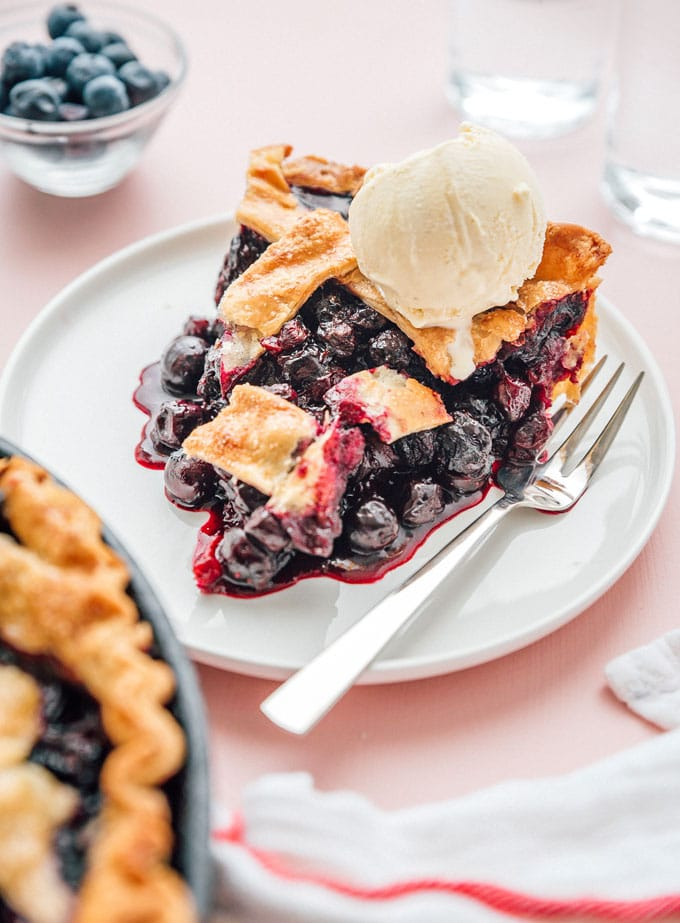 Slice of blueberry pie with ice cream