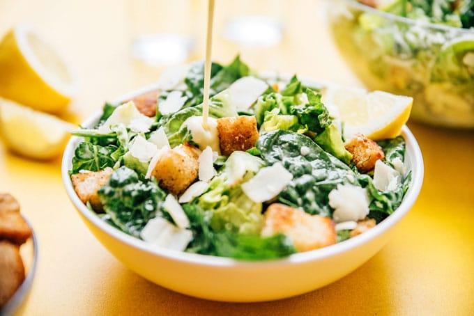Caesar salad in a bowl with croutons, romaine lettuce, and parmesan