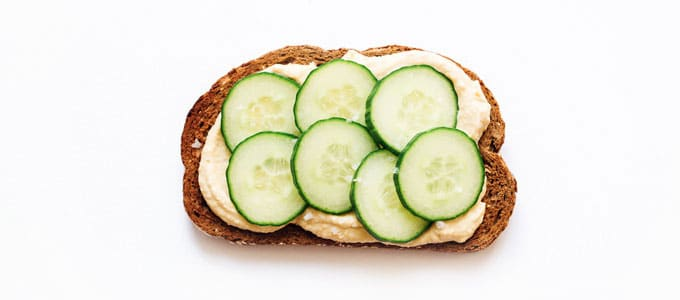 Healthy toast topping with hummus and cucumber