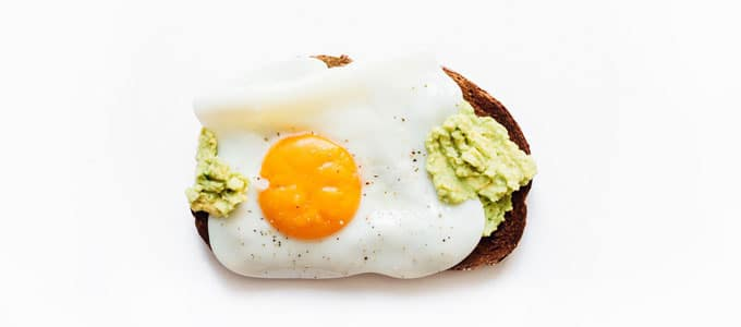 Healthy toast topping with mashed avocado and egg