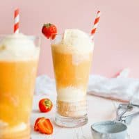 Kombucha ice cream float in a glass with a straw