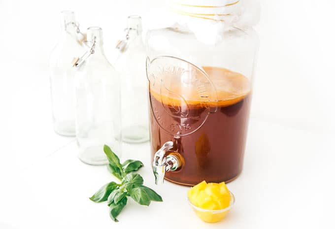 Pineapple kombucha in a jar on a white background