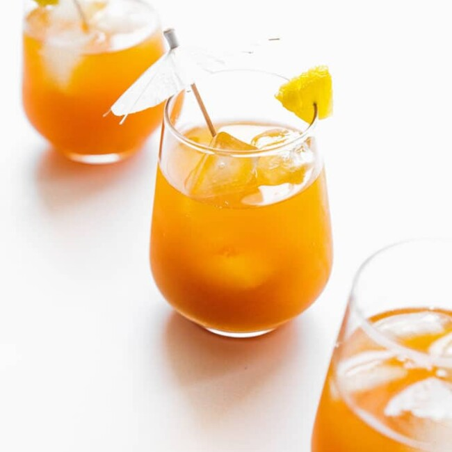 Pineapple kombucha in a glass on a white background