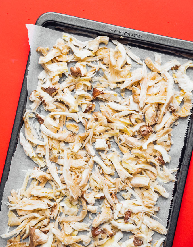 Shredded king oyster mushrooms on a pan