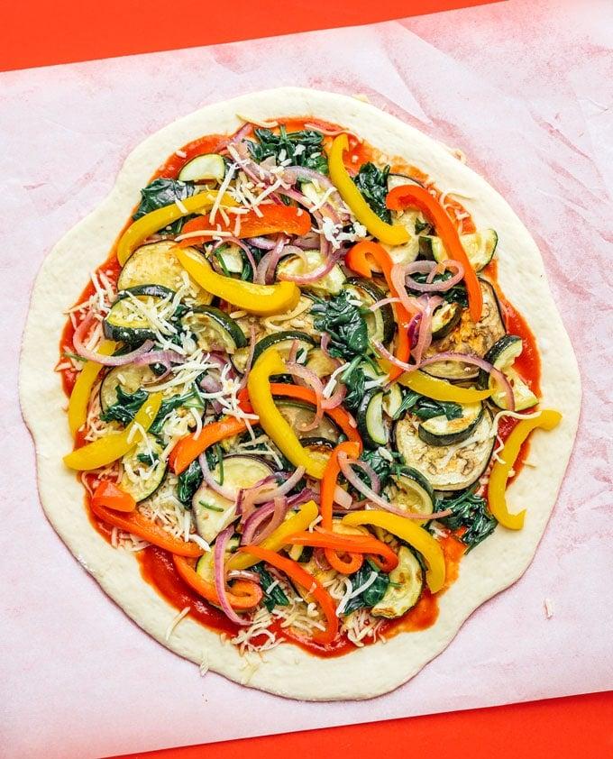 Vegetable pizza on parchment paper