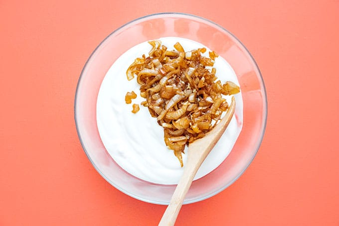 Mixing Greek yogurt with caramelized onions