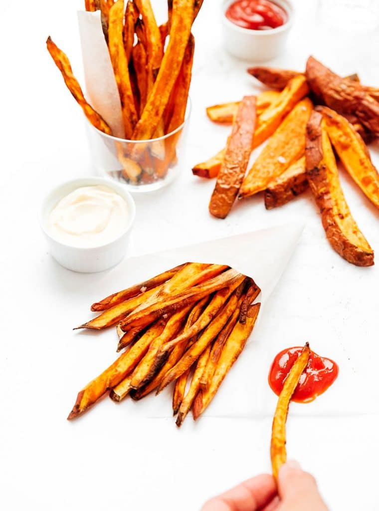 Air fryer sweet potato fries on a white background