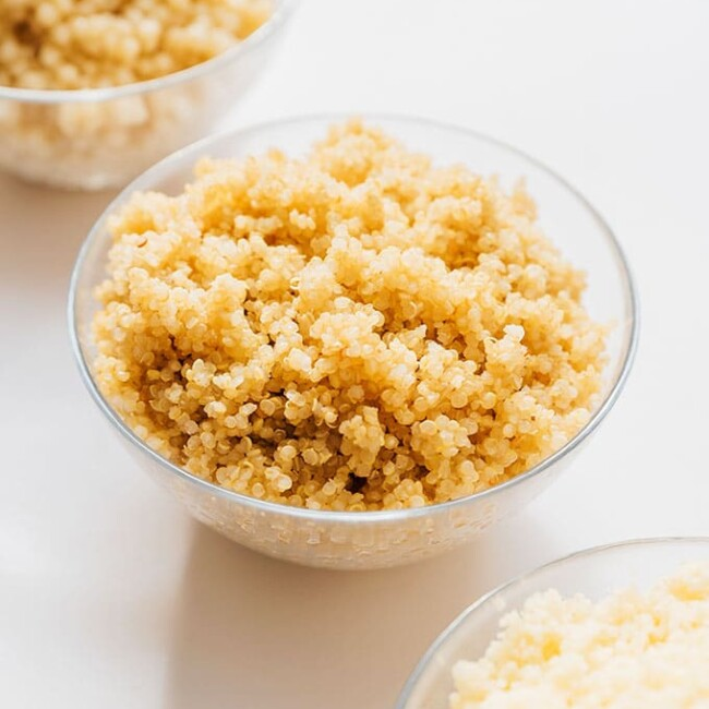 Couscous, quinoa, and pearl couscous in bowls on a white background