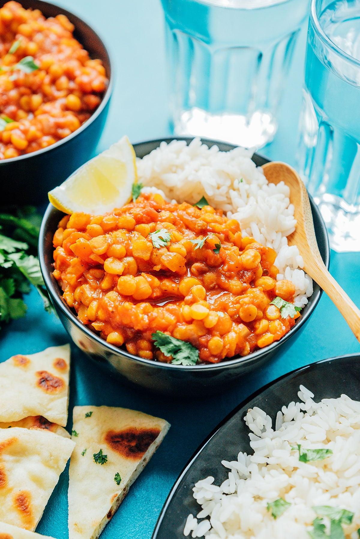 A bowl of chana dal (made from this easy chana dal recipe) and rice on a blue background