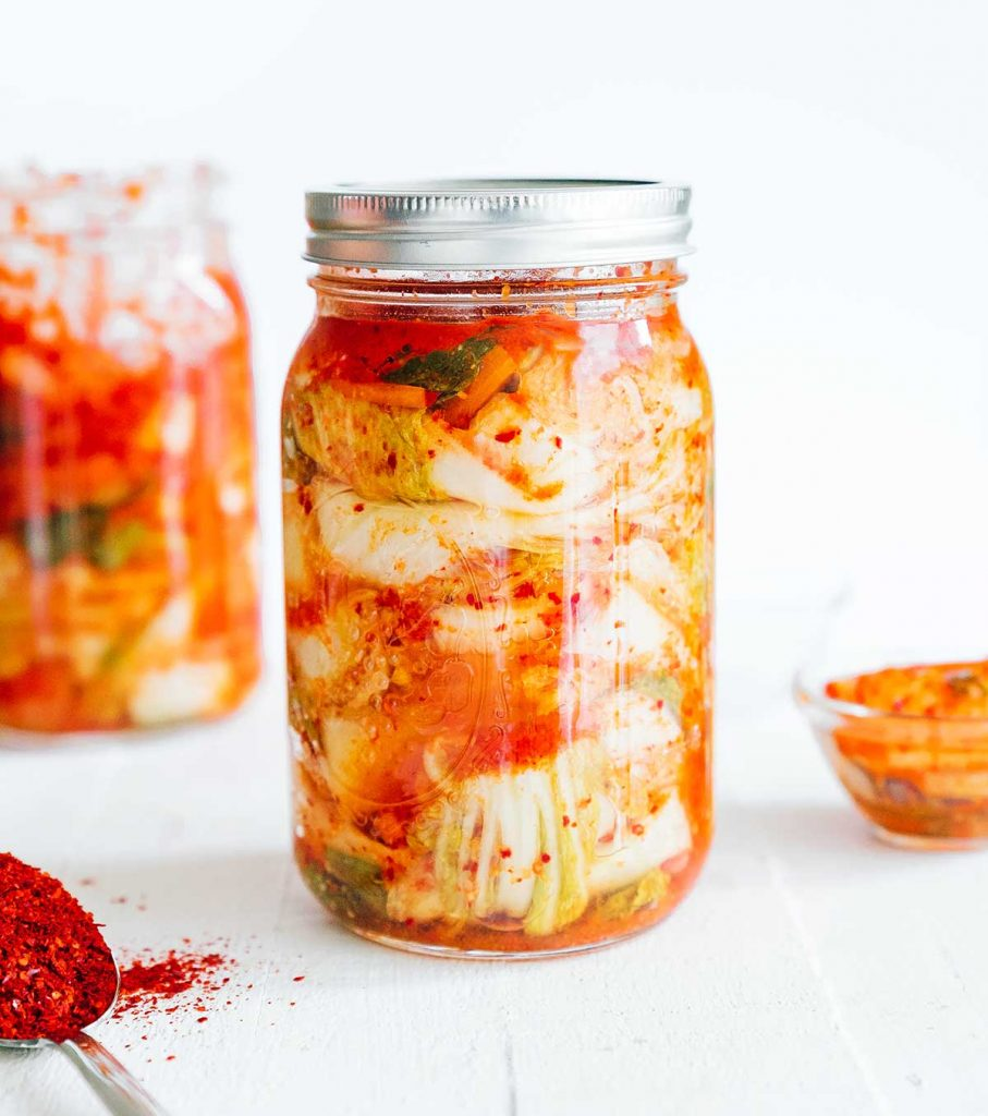 Homemade kimchi in a mason jar with white background