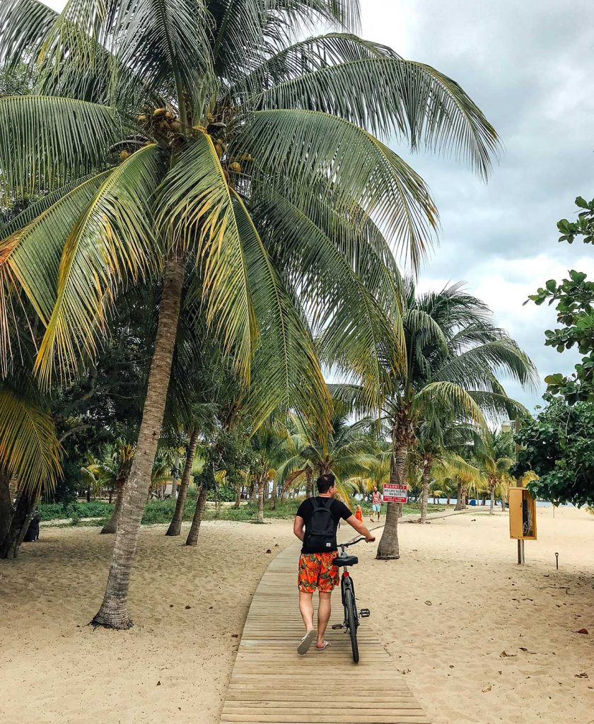 Walking with a bike on the beach in Belize