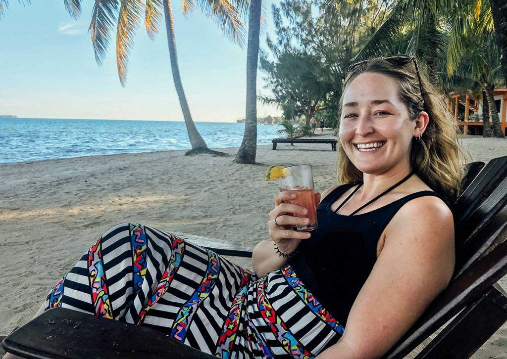 On the beach with a drink in Belize