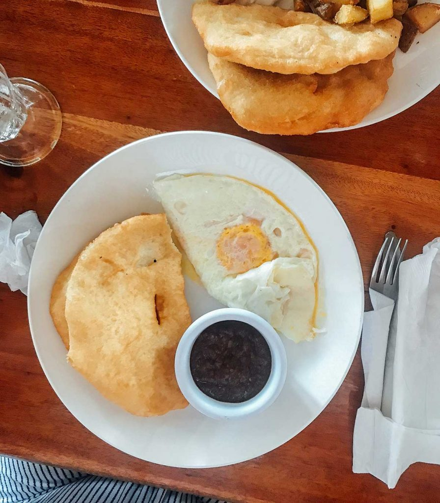 Fry jacks with egg and refried beans in Belize