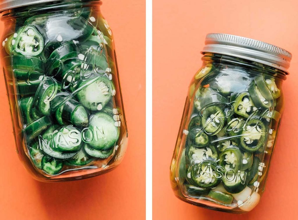 Mason jars filled with pickled jalapeños