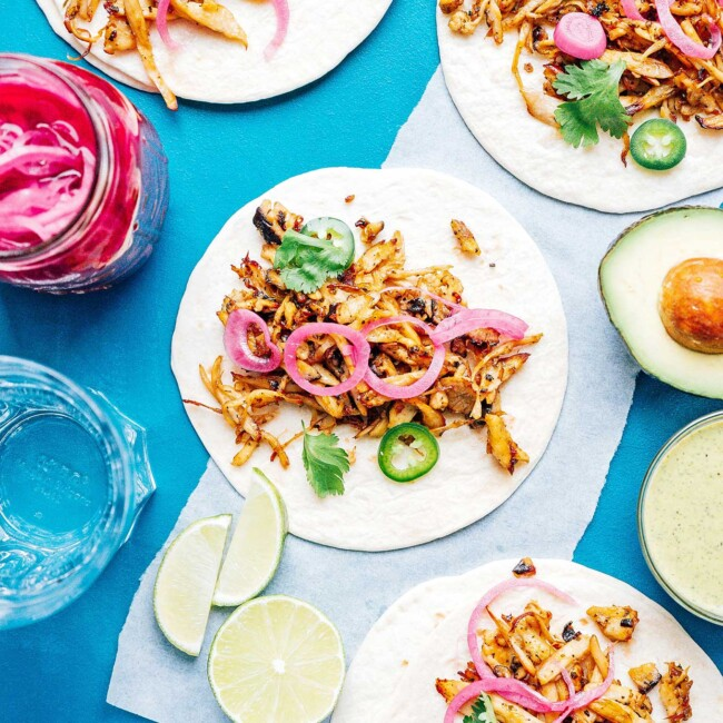 Mushroom carnitas tacos on a blue background