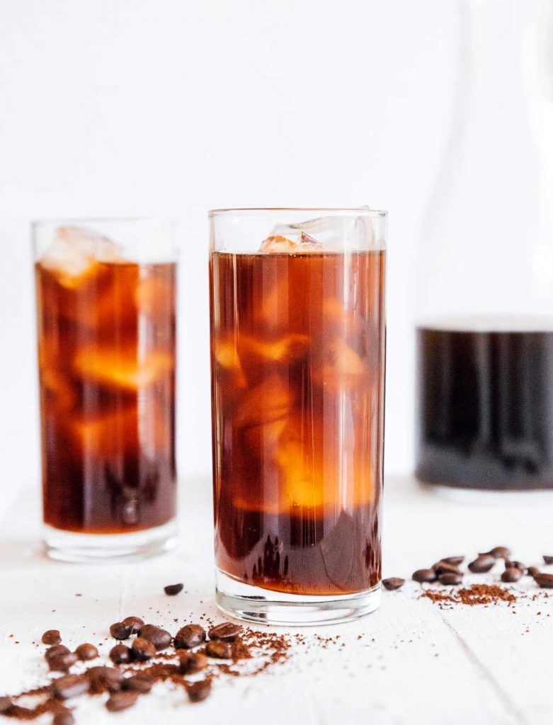 Two tall glasses of iced cold brew coffee