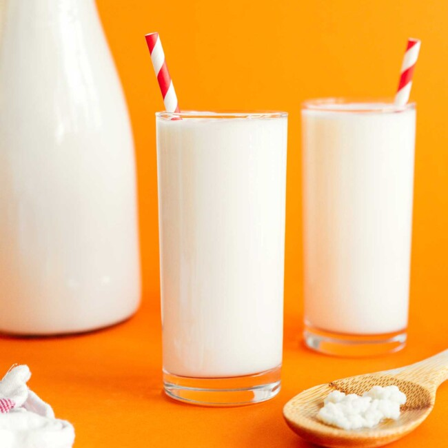 Kefir in a glass on an orange background