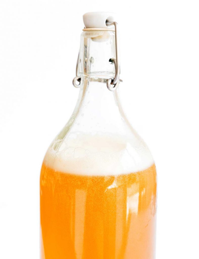 Carbonation bubbles in a second fermentation bottle