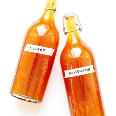 Coffee kombucha in fermentation bottles on a white background