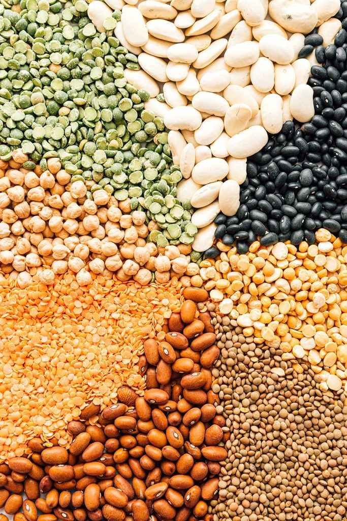 Rainbow of different types of dried legumes