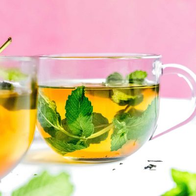 Moroccan mint tea in a glass on a pink background