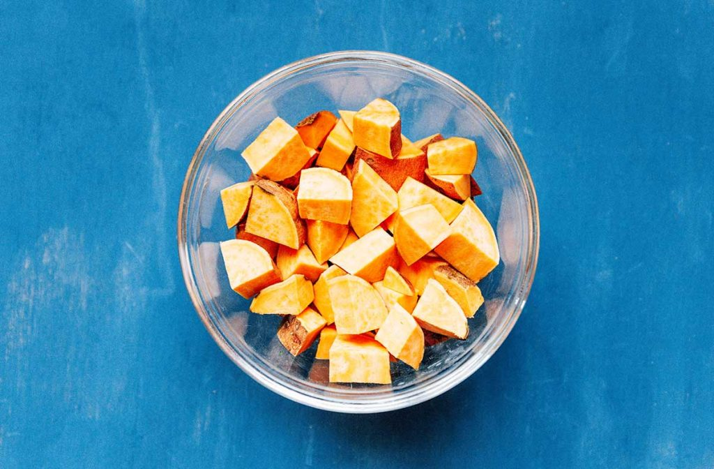 A bowl filled with diced sweet potato