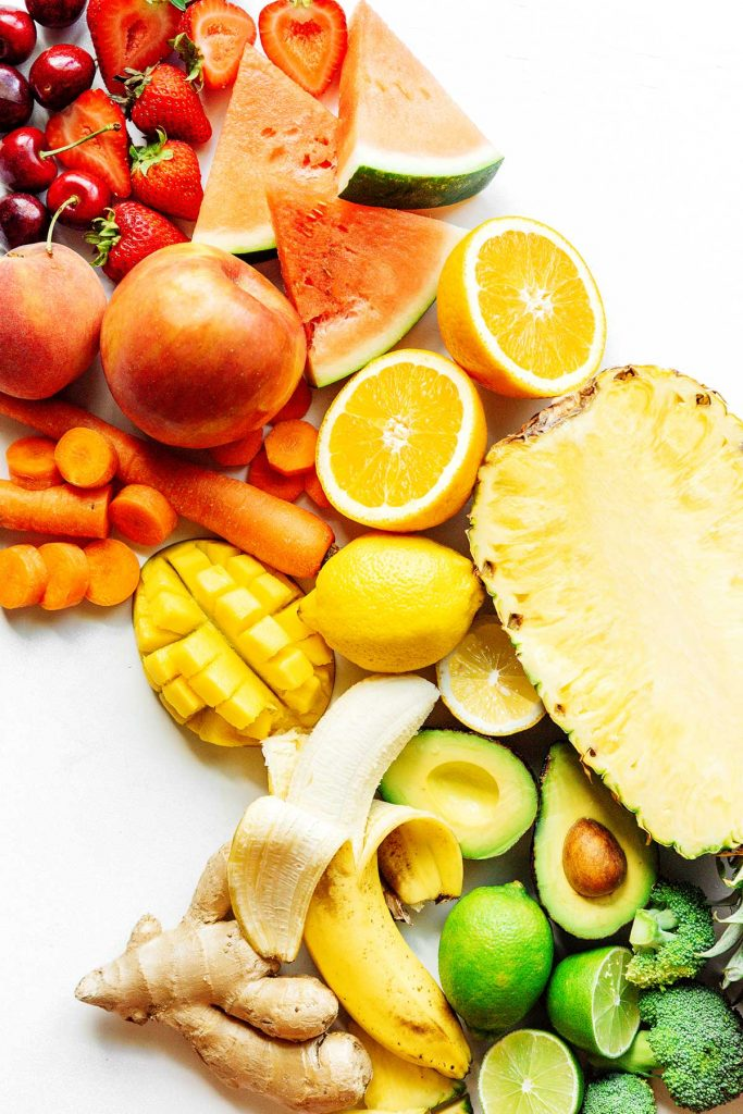 Assorted fruits and veggies on a white background